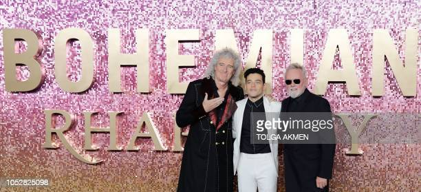 US actor Rami Malek poses on the red carpet with British musician and drummer of the rock band Queen Roger Taylor and British musician and lead...