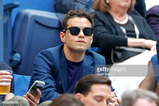 Actor Rami Malek watches the Men's Singles final match between Daniil Medvedev of Russia and Novak Djokovic of Serbia on Day Fourteen of the 2021 US...
