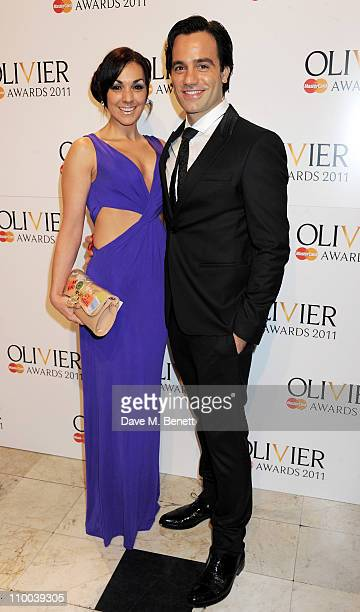 Actor Ramin Karimloo and Mandy Karimloo arrive at the Olivier Awards 2011 at Theatre Royal Drury Lane on March 13 2011 in London England