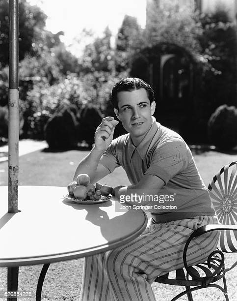 Actor Ramon Novarro Eating Breakfast