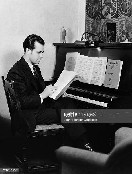 Actor Ramon Novarro Reading at Piano