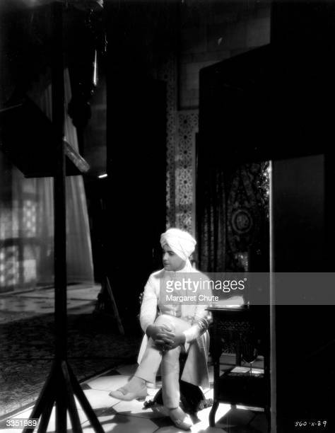 Actor Ramon Novarro , real name Jose Samiegos, caught resting between takes of his new MGM film 'Son of India'.