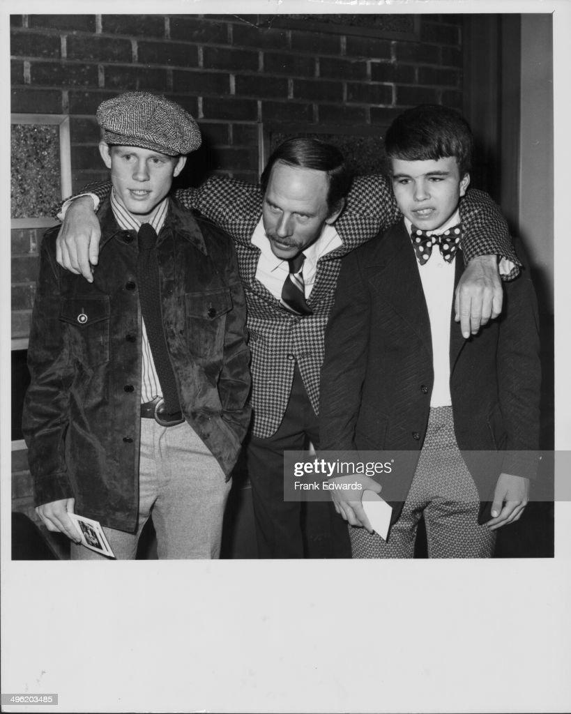 Actor Rance Howard with his arms around his sons Ron and Clint, also actors, at a screening of the movie 'Where the Lilies Bloom', at the Screen Directors Guild, Hollywood, February 1974.