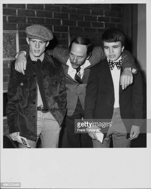 Actor Rance Howard with his arms around his sons Ron and Clint also actors at a screening of the movie 'Where the Lilies Bloom' at the Screen...