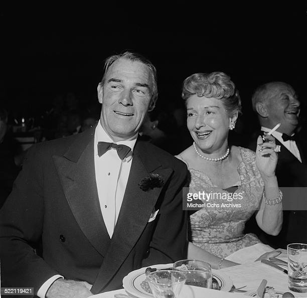Actor Randolph Scott and wife Patricia Stillman attend the Friars Dinner in Los AngelesCA