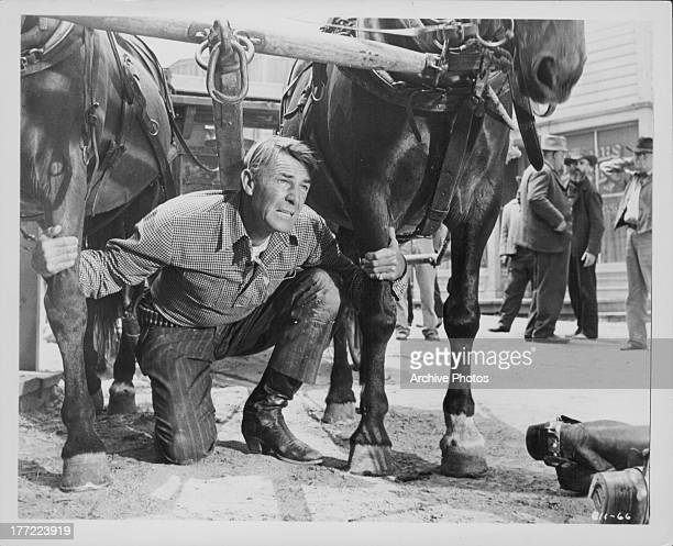 Actor Randolph Scott in a scene from the movie 'Tall Man Riding' 1955