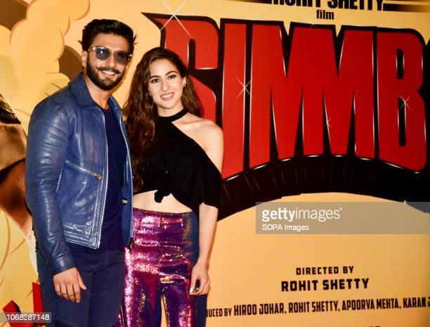 Actor Ranveer Singh and actress Sara Ali Khan are seen posing for a photo during the upcoming trailer launch of the movie 'SIMMBA' at the PVR Icon...