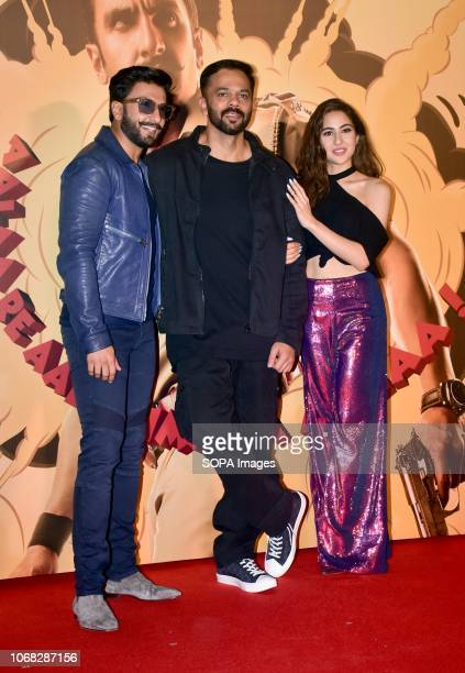 Actor Ranveer Singh Director Rohit Shetty and actress Sara Ali Khan are seen posing for a photo during the upcoming trailer launch of the movie...