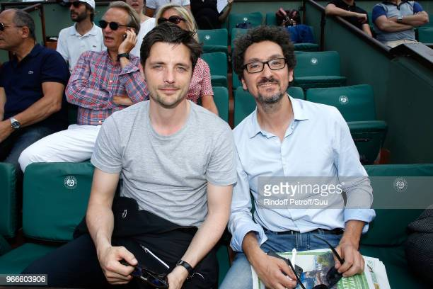 Actor Raphael Personnaz and writer David Foenkinos attend the 2018 French Open Day Eight at Roland Garros on June 3 2018 in Paris France