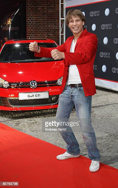 Actor Raul Richter poses with the new Golf GTI during the premiere of the Volkswagen Golf GTI at 'ewerk' on April 3 2009 in Berlin Germany