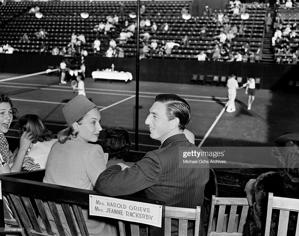 Actor Ray Bolger and his wife Gwendolyn attend the LA Tennis Open in Los Angeles, California.