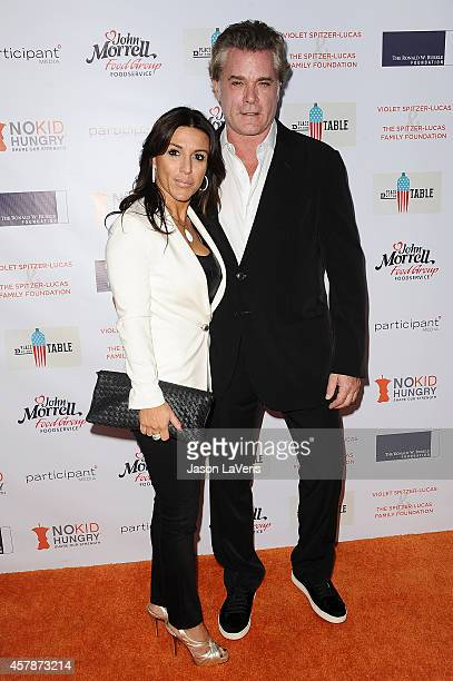 Actor Ray Liotta and guest attend the No Kid Hungry campaign fundraising dinner at Ron Burkle's Green Acres Estate on October 25 2014 in Beverly...