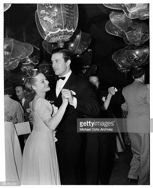 Actor Ray Milland dances with his wife Muriel Frances Weber during an event in Los Angeles California