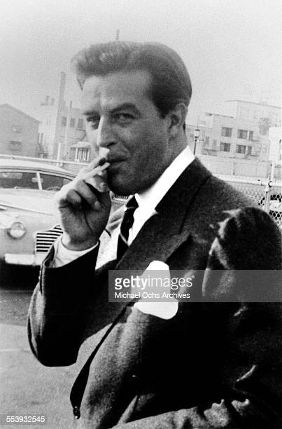 Actor Ray Milland poses on a street in Los Angeles, California.