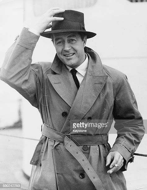 Actor Ray Milland wearing a raincoat and hat aboard the SS Queen Elizabeth arriving at Southampton England May 2nd 1947
