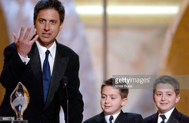 Actor Ray Romano accepts his award as his twins Matthew and Gregory look on during the 28th Annual Peoples Choice Awards at the Pasadena Civic Center...