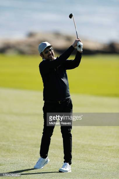 Actor Ray Romano plays a shot on the 18th hole during the 3M Celebrity Challenge prior to the ATT Pebble Beach ProAm at Pebble Beach Golf Links on...