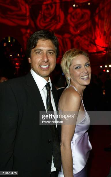 Actor Ray Romano poses actress Sharon Stone at HBO?S post Emmy party following the 56th annual Primetime Emmy Awards held at the Pacific Design...