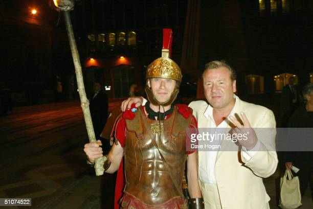 """Actor Ray Winstone gestures to photographers as he attends the afterparty following the European Premiere of """"King Arthur"""", on July 15, 2004 at the..."""
