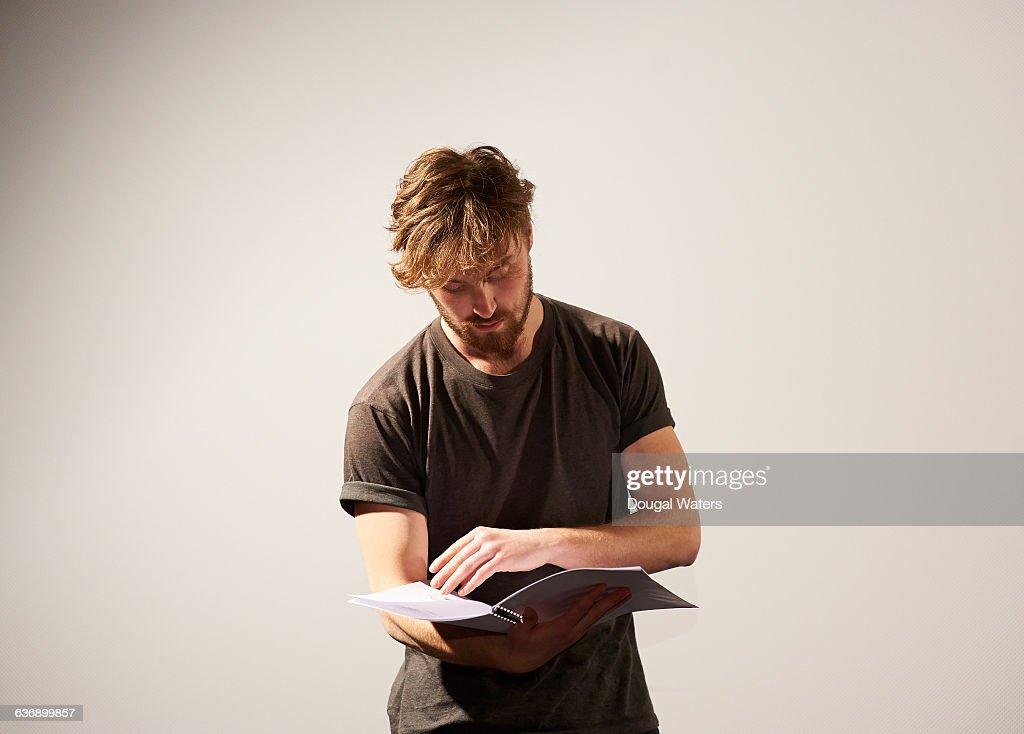 Actor reading script. : Stock-Foto