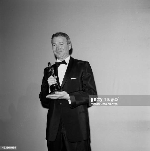 Actor Red Buttons poses with his Oscar for Best Supporting Actor in 'Sayonara' in Los Angeles California