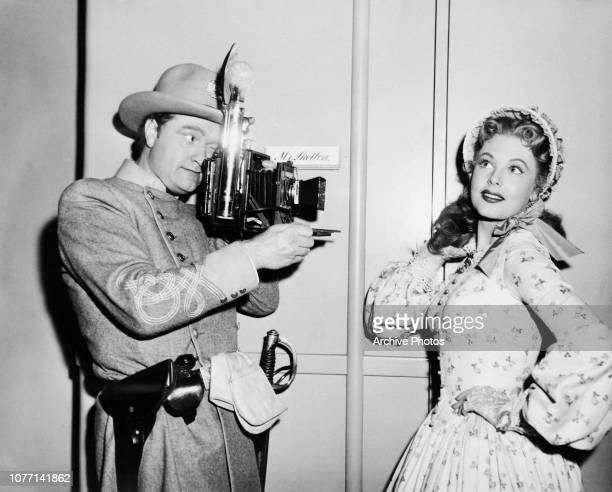 Actor Red Skelton photographs his costar Arlene Dahl on the set of the MGM film 'A Southern Yankee' 1948