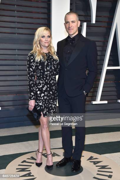 Actor Reese Witherspoon and Jim Toth attend the 2017 Vanity Fair Oscar Party hosted by Graydon Carter at Wallis Annenberg Center for the Performing...