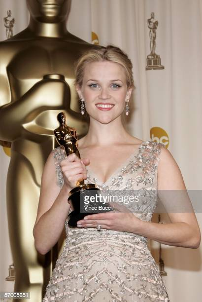 Actor Reese Witherspoon poses backstage with her Oscar statuette for Best Actress in a Leading Role for the film Walk the Line during the 78th Annual...