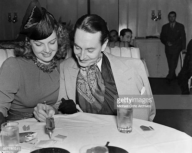 Actor Reginald Gardiner has dinner with actress Ann Sheridan in Los Angeles California