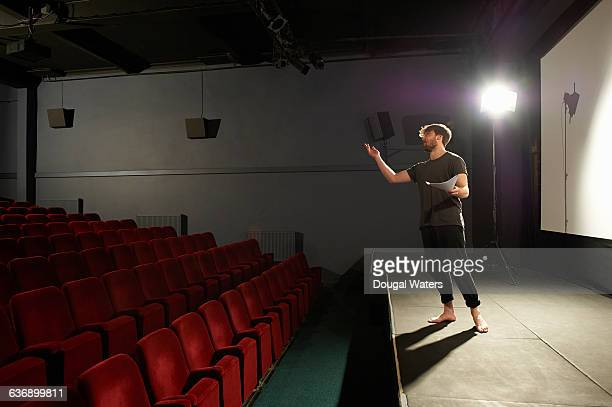 Actor rehearsing on stage.