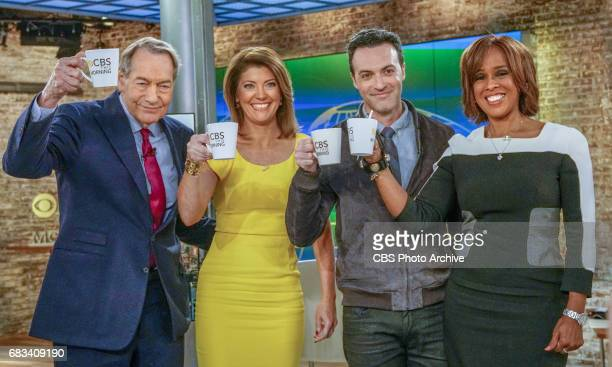 Actor Reid Scott second from right who plays a CTM anchor on the show 'VEEP' shares a toast with true anchors Charlie Rose Norah O'Donnel and Gayle...