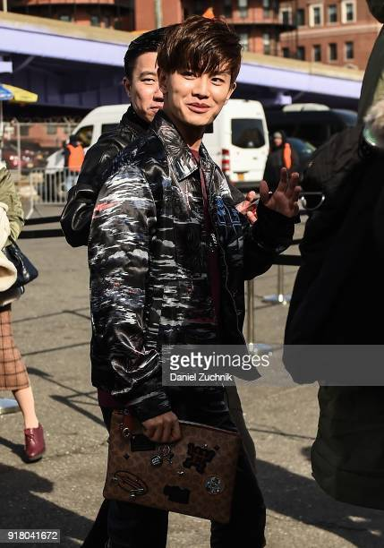 Actor Ren Jialun is seen outside the Coach show during New York Fashion Week Women's A/W 2018 on February 13 2018 in New York City