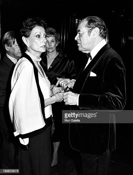 Actor Rex Harrison and wife Mercia Harrison attend the opening party for Aren't We All on April 29 1985 at Rainbow Room in New York City