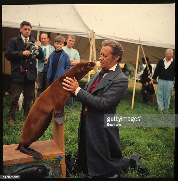 Actor Rex Harrison is shown with Sophie The Seal who co stars with him in the film Doctor Dolittle