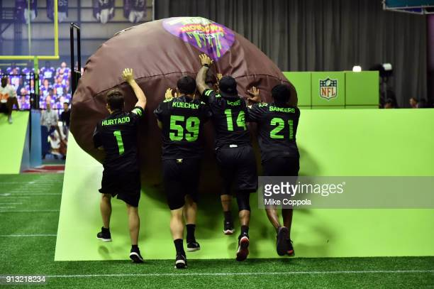 Actor Ricardo Hurtado NFL players Luke Kuechly Stefon Diggs and former NFL player Deion Sanders attend the Superstar Slime Showdown taping at...
