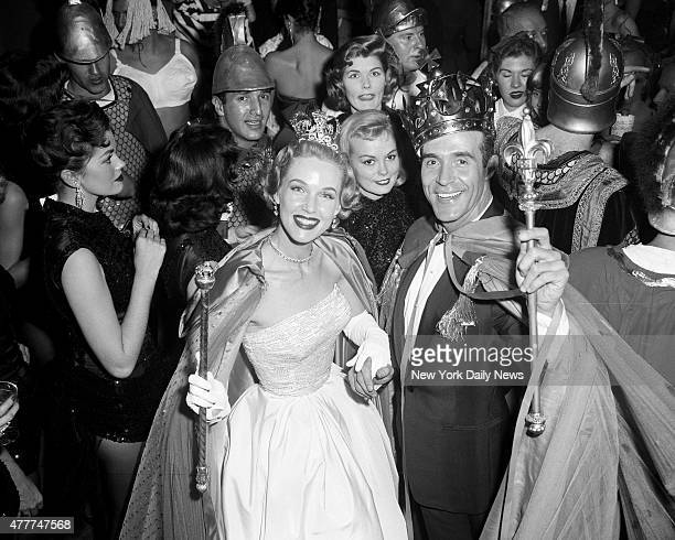 Actor Ricardo Montalban and actress Barbara Britton as they are jostled during their reign as king and Queen of the Artists and Models Ball at the...