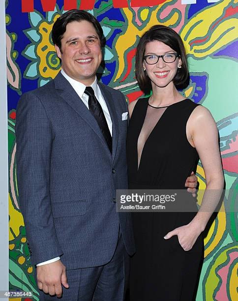 Actor Rich Sommer and Virginia Donohoe arrive at AMC's 'Mad Men' Season 7 premiere at ArcLight Cinemas on April 2 2014 in Hollywood California