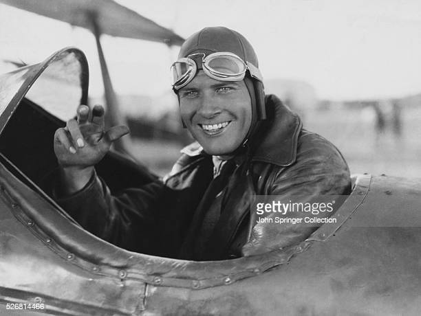 Actor Richard Arlen sits in a biplane on the set of the motion pictureWings