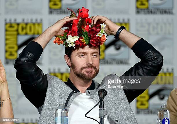 Actor Richard Armitage adjusts a flower crown as he attends the Hannibal Savor the Hunt panel during ComicCon International 2015 at the San Diego...