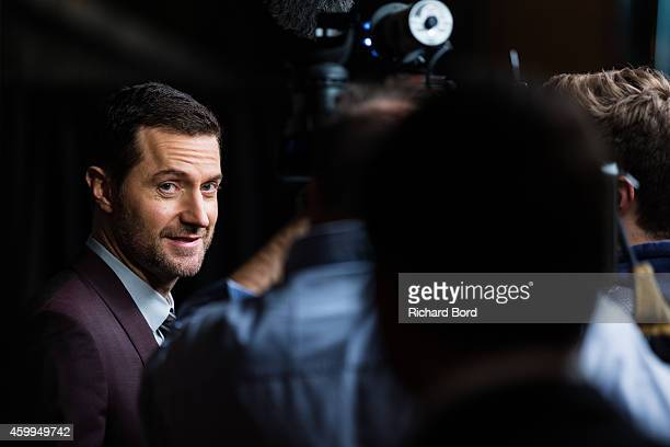 Actor Richard Armitage speaks to the medias as he attends 'The Hobbit The Battle Of The Five Armies' Paris Premiere at Le Grand Rex on December 4...