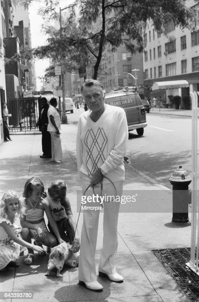 Actor Richard Burton out walking his dog near his New York Hotel He had recently been starring in 'Camelot' on Broadway but was taken ill during one...