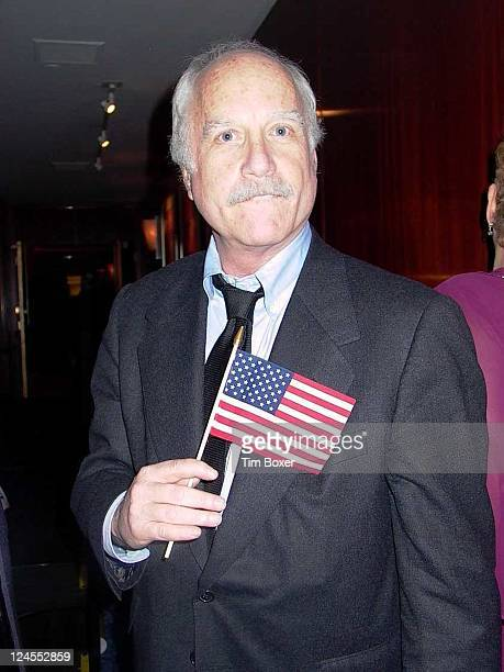Actor Richard Dreyfuss waves American flag in remembrance of the September 11 terrorist attack on World Trade Center at Jewish National Fund dinner...