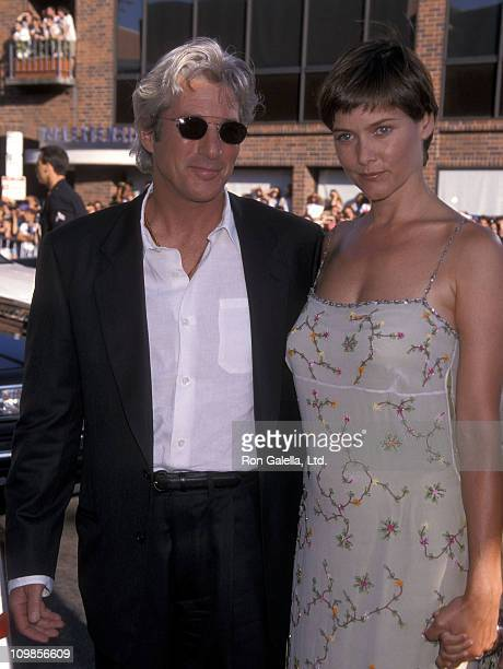 Actor Richard Gere and actress Carey Lowell attend the 'Runaway Bride' Westwood Premiere on July 25 1999 at Mann National Theatre in Westwood...