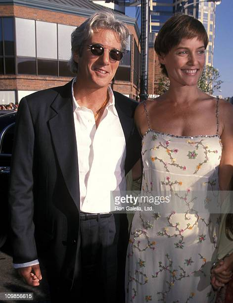Actor Richard Gere and actress Carey Lowell attend the Runaway Bride Westwood Premiere on July 25 1999 at Mann National Theatre in Westwood California