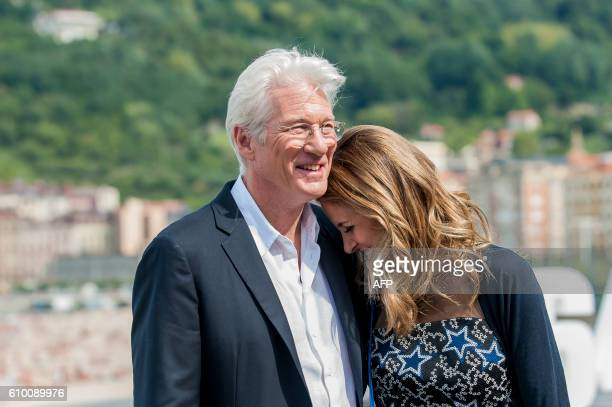 TOPSHOT US actor Richard Gere and his girlfriend Spanish publicist Alejandra Silva pose during a photocall after the screening the film Time out of...