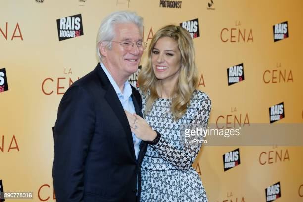 US actor Richard Gere and his partner Alejandra Silva pose on the red carpet as he arrives for the premiere of the film 'The dinner' in Madrid Spain