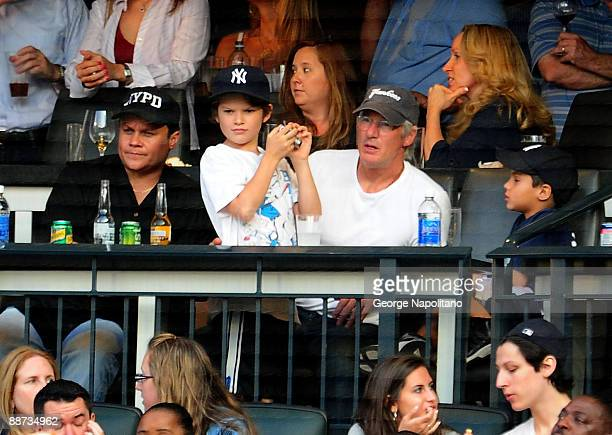 Actor Richard Gere and his son Homer attend the New York Subway Series game between the Mets and Yannkees at Citi Field on June 26, 2009 in New York,...