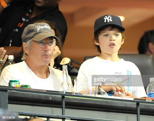 Actor Richard Gere and his son Homer attend theSubway Series game between the New York Mets and the New York Yankees at Citi Field on June 26, 2009...