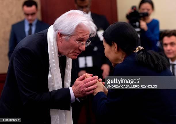 US actor Richard Gere bows to Dawa Chokyi the widow of Tibetan activist Lodi Gyari after a memorial event for Gyari at the US Capitol in Washington...