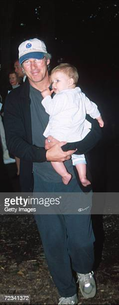 Actor Richard Gere carries his baby son Homer James Jigme Gere August 19 2000 at the Watermill Center 7th Annual Summer Gala Benefit in Watermill NY...